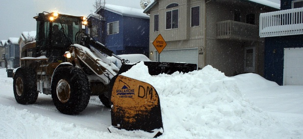 A snow plow clears a street in Anchorage, Alaska on March 25, 2013.