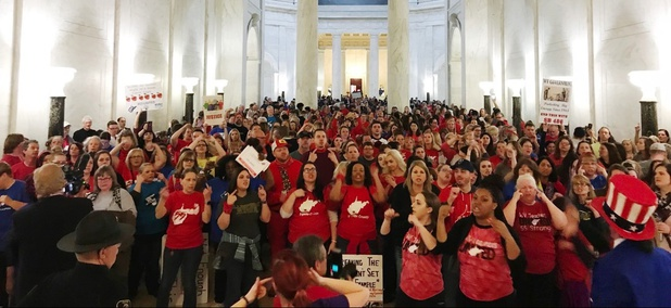 Teachers celebrate after West Virginia Gov. Jim Justice and Senate Republicans announced they reached a tentative deal to end a statewide teachers' strike by giving them 5 percent raises.