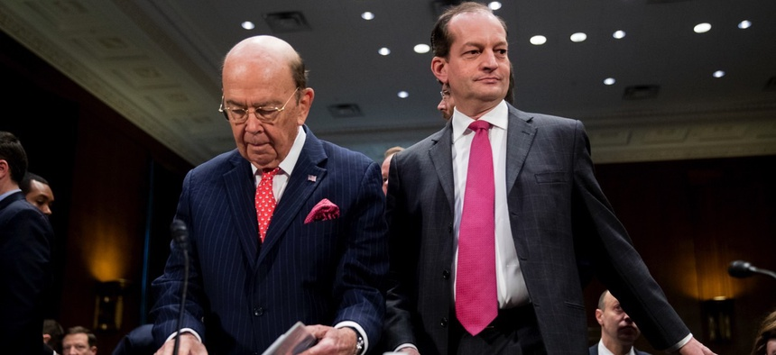 Commerce Secretary Wilbur Ross, center left, and Labor Secretary Alex Acosta, right, arrive before a Senate Committee on Commerce, Science, & Transportation hearing on infrastructure Wednesday in Washington, D.C.