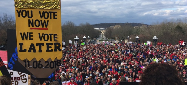 More than a thousand teachers and other public workers rally at the Kentucky Capitol to demonstrate against proposed changes to the state's pension system on Monday in Frankfort.