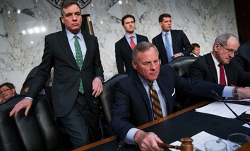 Senate Intelligence Chairman Richard Burr, R-N.C., center, accompanied by Committee Vice Chairman Mark Warner, D-Va., left, and Sen. Jim Risch, R-Idaho, right.