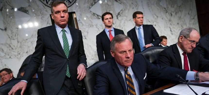 Senate Intelligence Chairman Richard Burr, R-N.C., center, accompanied by Committee Vice Chairman Mark Warner, D-Va., left, and Sen. Jim Risch, R-Idaho, right.