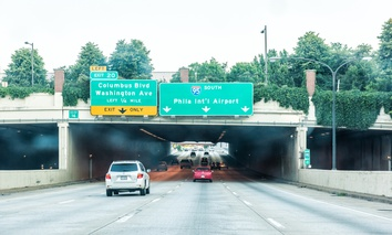 In Philadelphia, part of Interstate 95 is decked over in the vicinity of the Old City and Queen Village neighborhoods and the city's Delaware River waterfront.