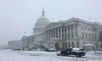 The U.S. Capitol during a snow storm on Wednesday, March 21, 2018.