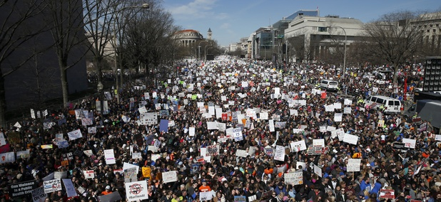 "Looking west, people fill Pennsylvania Avenue during the ""March for Our Lives"" rally in support of gun control, Saturday, March 24, 2018, in Washington."
