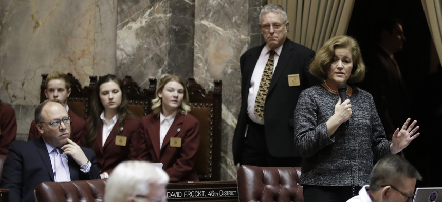 Washington state Sen. Christine Rolfes, right, speaks on the Senate floor during debate over the supplemental budget, Thursday, March 8, 2018 at the Washington State Capitol in Olympia.