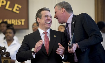 New York Gov. Andrew Cuomo, left, and New York City Mayor Bill de Blasio at the Wilborn Temple First Church of God In Christ in Albany, N.Y. on Feb. 16, 2014.