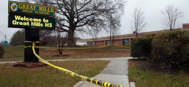Crime scene tape is used around Great Mills High School, the scene of a shooting, March 20 in Great Mills, Maryland.