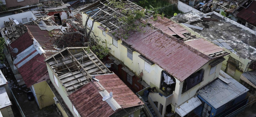 In this Nov. 15, 2017 photo, some roofs damaged by the whip of Hurricane Maria are shown still exposed to rainy weather conditions, in San Juan, Puerto Rico.
