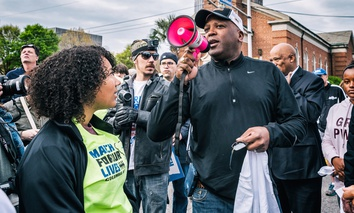 "Columbia, S.C. Mayor Steve Benjamin speaks to a crowd of march participants before embarking on the ""March for Our Lives"" through downtown Columbia on March 24."