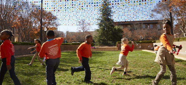 "Children play under Mobile Suspension, by artist Erwin Redl, part of the city of Spartanburg's public art project, ""Seeing Spartanburg in a New Light."""