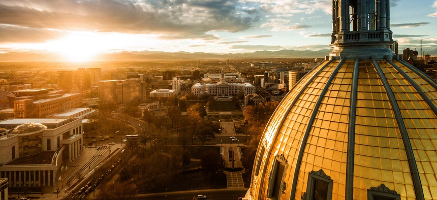 A sunset over the Colorado state capital building.