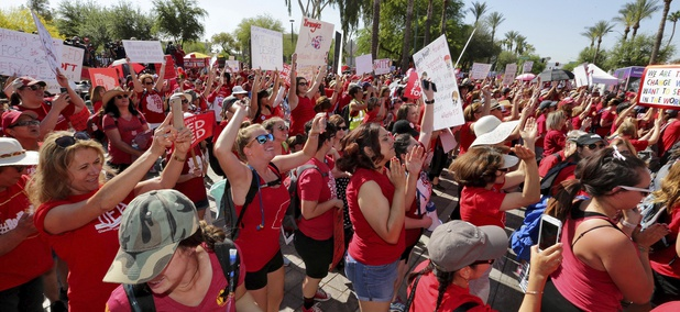 Teachers rally outside the Capitol, Friday, April 27, 2018, in Phoenix, on their second day of walkouts.