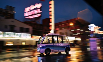 A Navya Arma autonomous vehicle drives down a street in Las Vegas. The driverless electric shuttle began carrying passengers as part of a 2017 pilot.