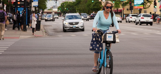 A woman rides a Divvy bike in Chicago. The city hopes dockless bike sharing will complement the existing system and other mobility options.