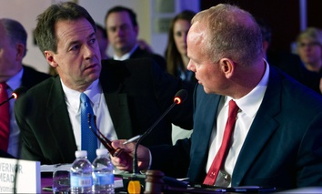 Montana Gov. Steve Bullock speaks with Wyoming Gov. Matt Mead during the National Governor Association winter meeting on Feb. 24 in Washington, D.C.