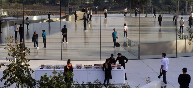 People arrive for a new product announcement at the Steve Jobs Theater on the new Apple campus in Cupertino, Calif.