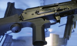 "In this Oct. 4, 2017, photo, a device called a ""bump stock"" is attached to a semi-automatic rifle at the Gun Vault store and shooting range in South Jordan, Utah."