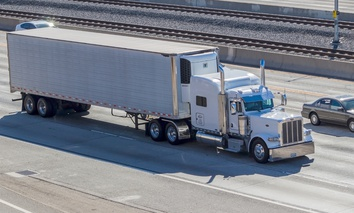 A semi truck travels on a Southern California freeway.
