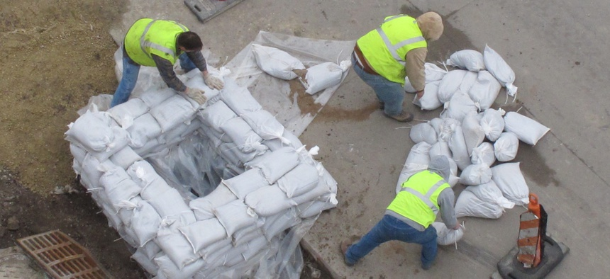 Workers fill up a pallet of sandbags outside of Modern Woodmen Park in Davenport, Iowa on Tuesday, March 22, 2011.
