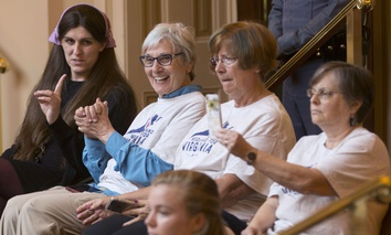 Del. Danica Roem, D-Prince William, left, talks with supporters of Medicaid expansion on May 30, 2018.