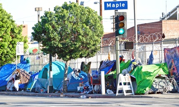 MARCH 25, 2018: Homeless encampment along the roadside depicting the growing epidemic of homelessness in the City of Los Angeles.
