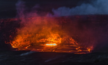April 22, 2018: Kilauea Volcano's summit lava lake overflows onto Halemaumau Crater in Hawaii Volcanoes National Park on Hawaii's Big Island.