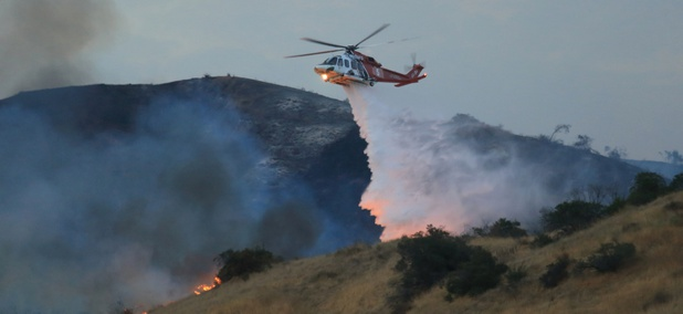 Sept. 2, 2017: A Los Angeles Fire Department helicopter drops flame retardant on the La Tuna Fire that's burned over 8,000 acres (one of the largest fires in L.A. history.)