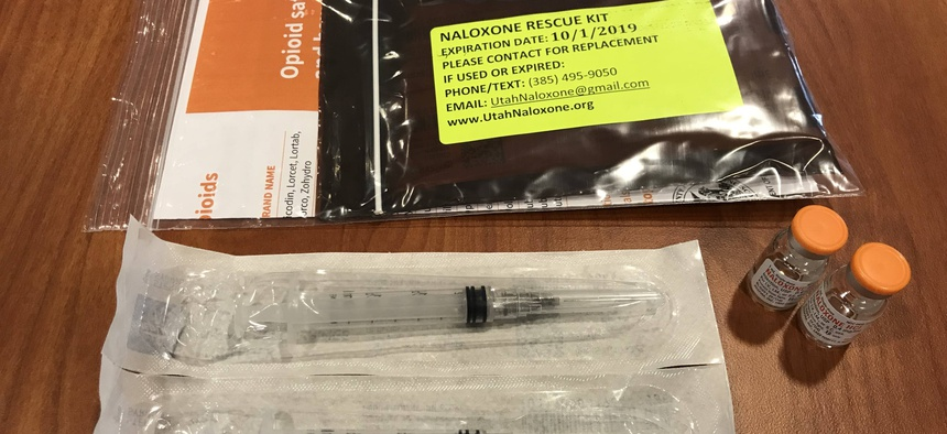 Each naloxone kit contains two syringes of the injectable overdose antidote, along with an information card.