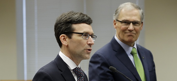 Washington State Attorney General Bob Ferguson, left, and Gov. Jay Inslee.