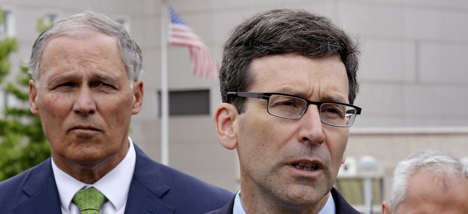 Washington state Attorney General Bob Ferguson, right, speaks as Gov. Jay Inslee looks on at a news conference announcing a lawsuit against the Trump administration over a policy of separating immigrant families illegally entering the United States.