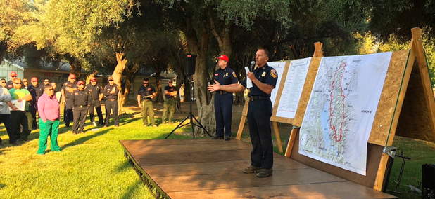 Chief Ken Pimlott, who directs the Cal Fire, addresses fire crews at a County Fire briefing on Monday morning.