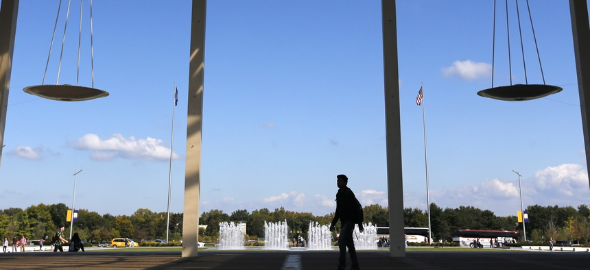 In this 2014 file photo, people walk on the SUNY campus of the University at Albany, in Albany, N.Y.