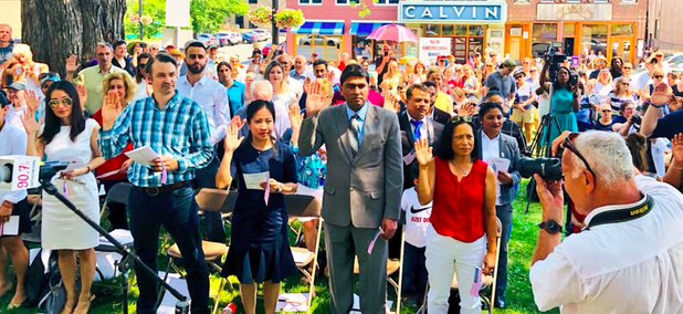 New U.S. citizens are sworn in at a naturalization ceremony on July 4 in Northampton, Massachusetts.