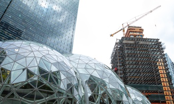 SEATTLE, WASHINGTON/USA - May 29, 2018: Wide angle view on the glass Spheres at the Seattle Amazon headquarters, with Day One office tower and new building under construction in the background.