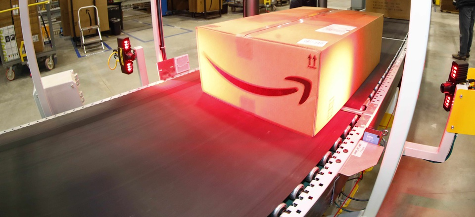 A box gets an address label during a tour of the Amazon fulfillment center Thursday, May 3, 2018, in Aurora, Colo.