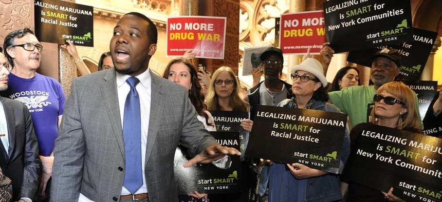 Chris Alexander, policy coordinator for Drug Policy Alliance, speaks as advocates urge New York state legislators to support the Marijuana Regulation and Taxation Act at the state Capitol, Tuesday, May 8, 2018, in Albany, New York.