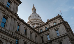 Michigan state Capitol. A new survey found increased optimism among local officials about direction of the state.
