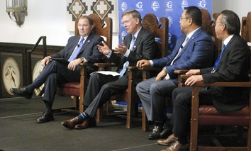 From left to right, Republican Utah Gov. Gary Herbert, Democratic Colorado Gov. John Hickenlooper, International Vitamin Corp. CEO Dai Ming, and Jushi USA Fiberglass CEO William Woo talk about trade in Santa Fe, New Mexico.