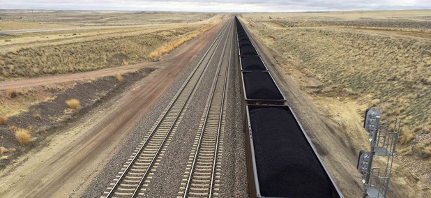 In this March 28, 2017, file photo, a train near hauls coal mined from Wyoming's Powder River Basin near Bill, Wyo.
