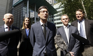 Washington Attorney General Bob Ferguson, center.