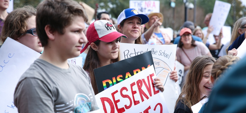 "Tallahassee, Florida - February 21, 2018. A huge crowd participated at a ""Never Again"" rally to protest and change gun laws after the shooting at Marjory Stoneman Douglas High School."