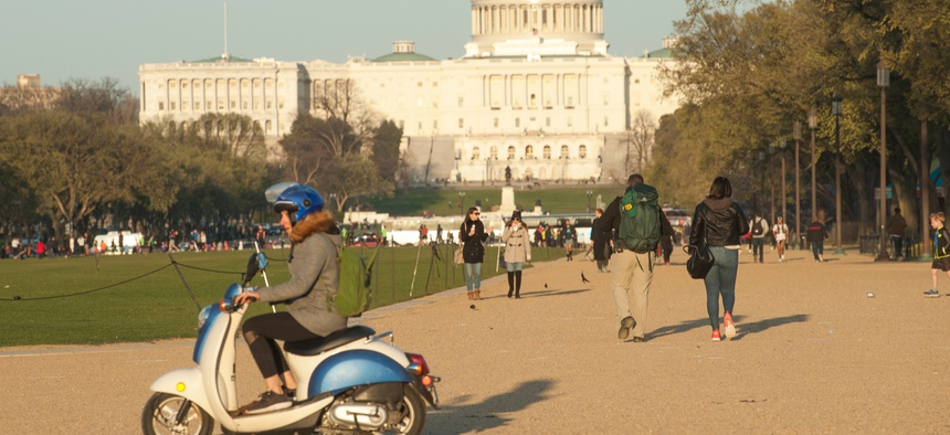 Washington DC, USA 04/06/2018- Visitors to the national mall take a stroll before sunset approaches.