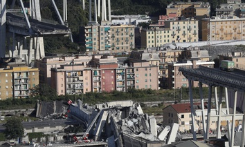 A view of the Morandi highway bridge after a section of it collapsed, in Genoa, northern Italy, Tuesday, Aug. 14, 2018.