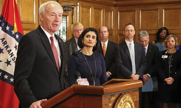 Gov. Asa Hutchinson speaks at a news conference Monday, March 5, 2018, at the state Capitol in Little Rock, Ark., with Seema Verma, the head of the Centers for Medicare and Medicaid Services about work requirements.