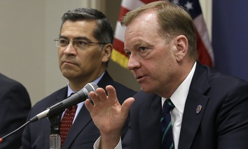 McGregor Scott, right, the United States Attorney for the Eastern District of California, accompanied by California Attorney General Xavier Becerra, discusses illegal marijuana farms hidden on public lands Tuesday, May 29, 2018, in Sacramento, Calif.