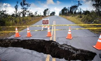 A large sinkhole at the Kilauea Overlook intersection inside Hawaii Volcanoes National Park on Hawaii.