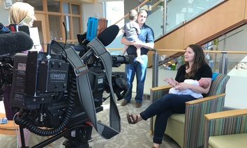 """An Iowa TV station interviews Emily Eekhoff of Ankeny, Iowa, in 2017, soon after her daughter Ruby was born. Eekhoff said that """"counting the kicks"""" in Ruby's third trimester led her to alert her doctor to the baby's distress and an emergency C-section."""
