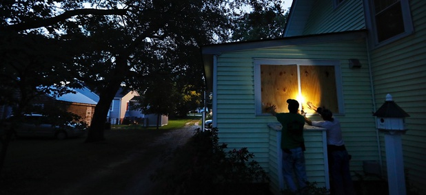 Russell Meadows, left, helps neighbor Rob Muller board up his home ahead of Hurricane Florence in Morehead City, North Carolina on Tuesday.