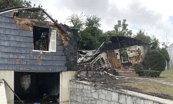 One of multiple houses that went up in flames on Thursday afternoon after gas explosions and fires triggered by a problem with a gas line that feeds homes in several communities north of Boston